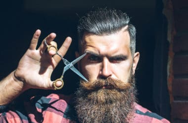 Man hipster with scissors