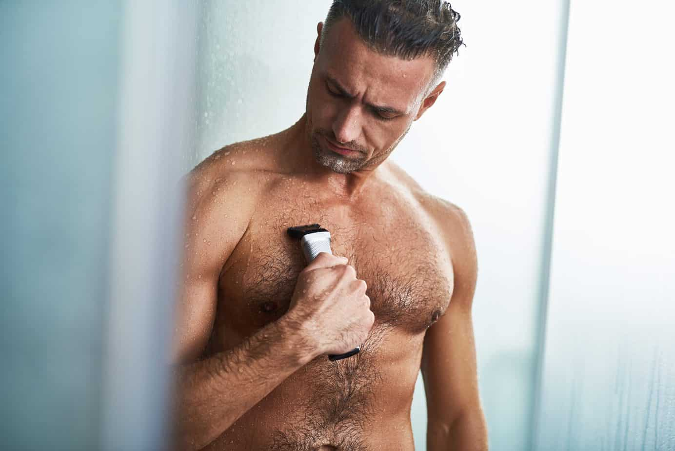 man shaving chest after shower